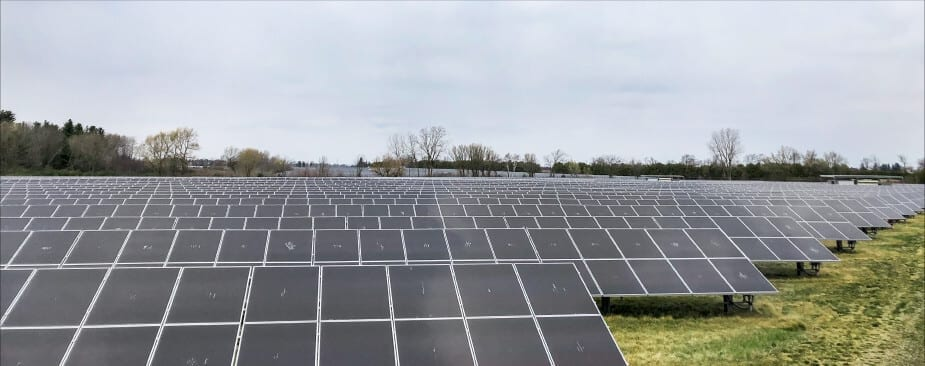 A picture of a field of solar panels installed on the ground